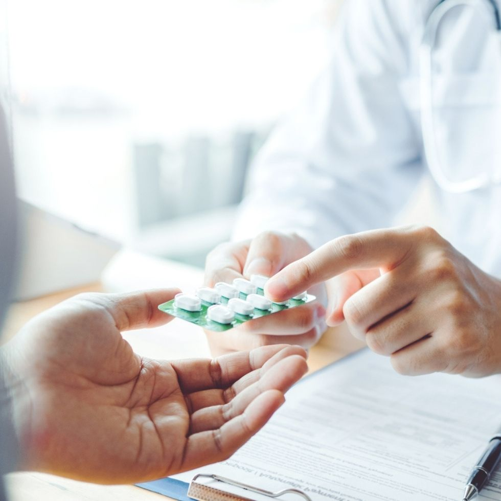 Doctor or physician recommend pills medical prescription to male Patient hospital and medicine concept, discussing Chemistry-Based Medication Reconciliation and Monitoring May Enhance Chronic Care Management.